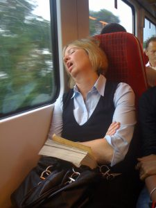 lady snoring on train