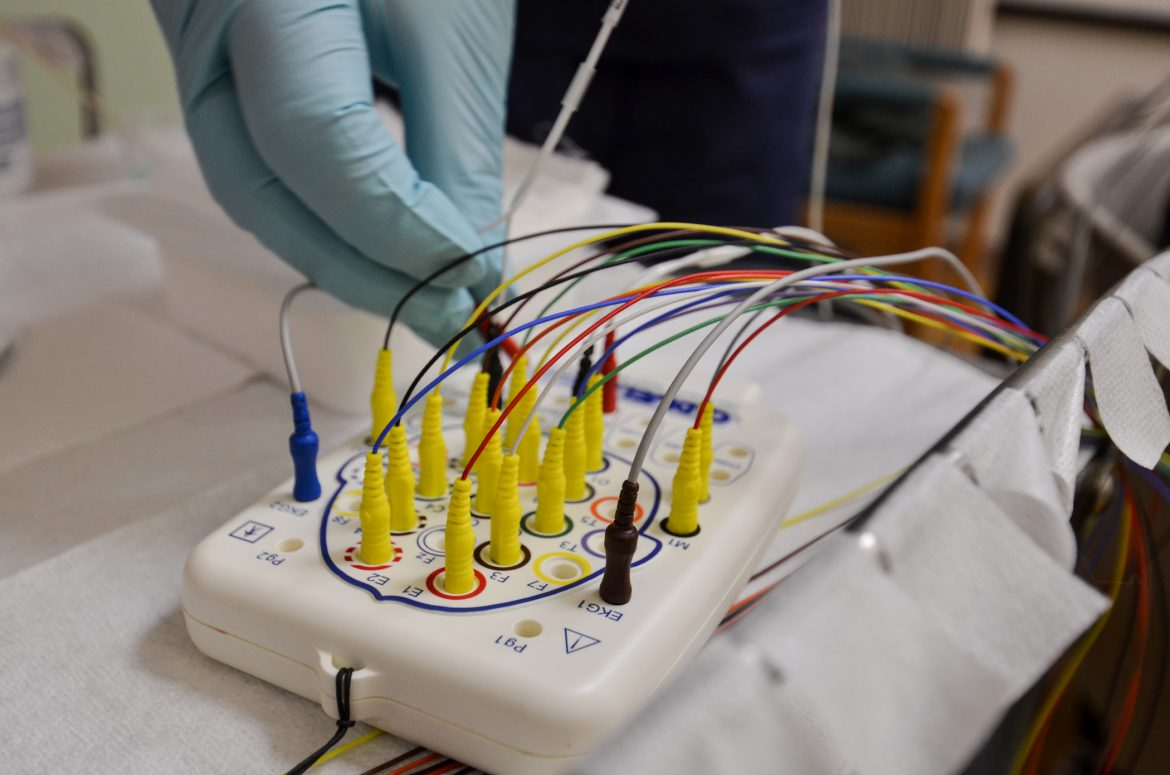 Christopher_Taylor,_a_sleep_technician_wiring_for_a_study